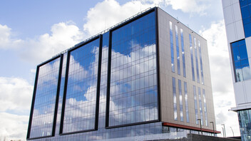 Bonarka For Business, Building F of B4B Office Park in Krakow, Poland, cladded with Rockpanel Woods facade cladding